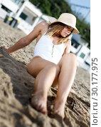 Купить «Female in swimsuit taking sunbath at sand at sea shore on sunny day», фото № 30177975, снято 10 июля 2018 г. (c) Яков Филимонов / Фотобанк Лори