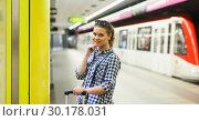 Купить «Portrait of glad girl waiting for train», фото № 30178031, снято 27 апреля 2018 г. (c) Яков Филимонов / Фотобанк Лори
