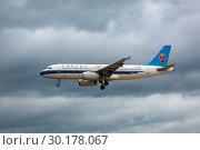 Купить «Airbus China flies in the sky», фото № 30178067, снято 27 ноября 2016 г. (c) Игорь Жоров / Фотобанк Лори