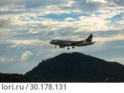 Купить «Spring Airlines flying in the night sky», фото № 30178131, снято 30 ноября 2016 г. (c) Игорь Жоров / Фотобанк Лори