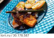 Купить «Dish of tasty fried salmon with potatoes and asparagus», фото № 30178587, снято 10 февраля 2019 г. (c) Яков Филимонов / Фотобанк Лори