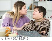 Купить «Woman wants to make peace with his son after arguing at table», фото № 30195943, снято 9 февраля 2019 г. (c) Яков Филимонов / Фотобанк Лори