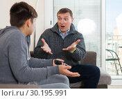Купить «Dissatisfied father scolds young son», фото № 30195991, снято 8 февраля 2019 г. (c) Яков Филимонов / Фотобанк Лори