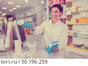 Купить «Female pharmacist offering help in choosing at counter in pharmacy», фото № 30196259, снято 31 января 2017 г. (c) Яков Филимонов / Фотобанк Лори