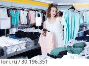 Купить «Woman shopping at the apparel store», фото № 30196351, снято 19 июня 2017 г. (c) Яков Филимонов / Фотобанк Лори