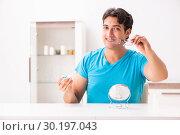 Купить «Man trying contact lenses at home», фото № 30197043, снято 6 августа 2018 г. (c) Elnur / Фотобанк Лори