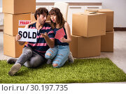 Купить «Young family selling their house», фото № 30197735, снято 21 сентября 2018 г. (c) Elnur / Фотобанк Лори
