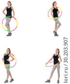 Купить «Young woman with hula hoop isolated on white», фото № 30203907, снято 26 марта 2019 г. (c) Elnur / Фотобанк Лори