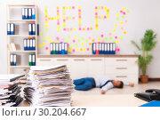 Купить «Young employee suffering from excessive work», фото № 30204667, снято 5 сентября 2018 г. (c) Elnur / Фотобанк Лори