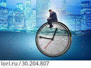 Купить «Businessman in deadline and time management concept», фото № 30204807, снято 19 марта 2019 г. (c) Elnur / Фотобанк Лори