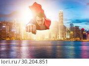 Купить «Superhero businessman flying over the city», фото № 30204851, снято 6 декабря 2019 г. (c) Elnur / Фотобанк Лори