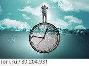 Купить «Businessman in deadline and time management concept», фото № 30204931, снято 19 марта 2019 г. (c) Elnur / Фотобанк Лори