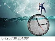 Купить «Businessman in deadline and time management concept», фото № 30204991, снято 19 марта 2019 г. (c) Elnur / Фотобанк Лори