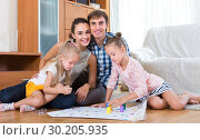 Family with board game at home. Стоковое фото, фотограф Яков Филимонов / Фотобанк Лори