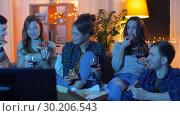 Купить «friends eating pizza and drinking wine at home», видеоролик № 30206543, снято 12 января 2019 г. (c) Syda Productions / Фотобанк Лори