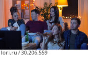 Купить «friends with drinks and snacks watching tv at home», видеоролик № 30206559, снято 12 января 2019 г. (c) Syda Productions / Фотобанк Лори