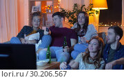 Купить «friends with drinks and snacks watching tv at home», видеоролик № 30206567, снято 12 января 2019 г. (c) Syda Productions / Фотобанк Лори