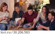 Купить «friends playing cards game at home in evening», видеоролик № 30206583, снято 12 января 2019 г. (c) Syda Productions / Фотобанк Лори