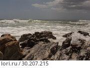 Купить «Sea waves splashing on the rock», фото № 30207215, снято 6 ноября 2018 г. (c) Wavebreak Media / Фотобанк Лори