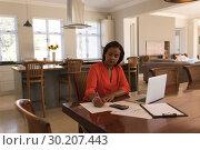 Купить «Woman calculating invoices at home», фото № 30207443, снято 7 ноября 2018 г. (c) Wavebreak Media / Фотобанк Лори