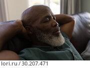 Купить «Senior man sleeping in living room», фото № 30207471, снято 7 ноября 2018 г. (c) Wavebreak Media / Фотобанк Лори