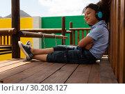 Купить «Schoolgirl listening music on headphones in the school playground», фото № 30208127, снято 17 ноября 2018 г. (c) Wavebreak Media / Фотобанк Лори