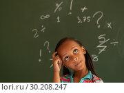 Купить «Schoolgirl standing against green board in a classroom at school», фото № 30208247, снято 17 ноября 2018 г. (c) Wavebreak Media / Фотобанк Лори