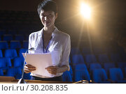 Купить «Businesswoman standing at podium on stage in auditorium», фото № 30208835, снято 15 ноября 2018 г. (c) Wavebreak Media / Фотобанк Лори