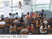 Купить «Male speaker with microphone speaks in a business seminar», фото № 30208927, снято 21 ноября 2018 г. (c) Wavebreak Media / Фотобанк Лори