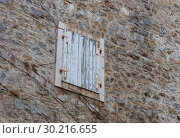 Купить «Closed wooden window in the  day. Wall in the old city, Budva, Montenegro», фото № 30216655, снято 21 февраля 2018 г. (c) Николай Коржов / Фотобанк Лори