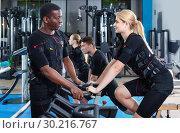 Купить «Athletic young people during functional workout with electric muscle stimulation in fitness gym», фото № 30216767, снято 16 апреля 2018 г. (c) Яков Филимонов / Фотобанк Лори