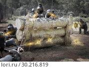 daring teams facing on battlefield in outdoor paintball arena. Стоковое фото, фотограф Яков Филимонов / Фотобанк Лори