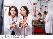 Купить «Scared girls with medical instruments in lost room», фото № 30216871, снято 8 октября 2018 г. (c) Яков Филимонов / Фотобанк Лори