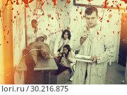 Купить «Young man in quest room with bloody traces», фото № 30216875, снято 8 октября 2018 г. (c) Яков Филимонов / Фотобанк Лори