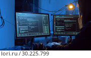 Купить «hacker creating computer virus for cyber attack», видеоролик № 30225799, снято 27 февраля 2019 г. (c) Syda Productions / Фотобанк Лори