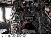 Купить «Russia, Khabarovsk, September 15, 2018: Museum of the History of the Amur Bridge, inside the cabin for the cougar, stove», фото № 30230031, снято 15 сентября 2018 г. (c) Катерина Белякина / Фотобанк Лори