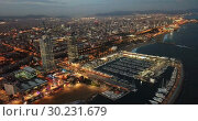 Купить «View from drones of coast in Barcelona and center with building», видеоролик № 30231679, снято 25 декабря 2018 г. (c) Яков Филимонов / Фотобанк Лори
