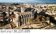 Купить «Aerial view of Manresa town with Basilica de Santa Maria, Catalonia, Spain», видеоролик № 30231695, снято 24 декабря 2018 г. (c) Яков Филимонов / Фотобанк Лори