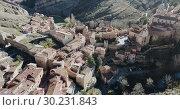 Купить «Aerial view of Albarracin - medieval town with fortress wall on hillside, Spain», видеоролик № 30231843, снято 26 декабря 2018 г. (c) Яков Филимонов / Фотобанк Лори
