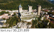 Купить «Aerial view of mountainscape in commune of Foix with ancient fortified castle of Chateau de Foix, Ariege, France», видеоролик № 30231899, снято 26 октября 2018 г. (c) Яков Филимонов / Фотобанк Лори