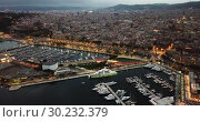 Купить «Aerial view of old port in Barcelona city with of sailboats and yachts and historical part of the city at night», видеоролик № 30232379, снято 1 сентября 2018 г. (c) Яков Филимонов / Фотобанк Лори