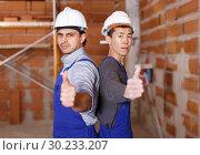 Купить «Builders doing finishing work», фото № 30233207, снято 12 февраля 2019 г. (c) Яков Филимонов / Фотобанк Лори
