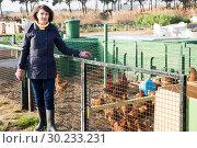 Купить «Girl farmer caring for poultry», фото № 30233231, снято 22 мая 2019 г. (c) Яков Филимонов / Фотобанк Лори