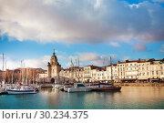 Купить «Downtown, clocktower and marina in La Rochell», фото № 30234375, снято 2 декабря 2017 г. (c) Сергей Новиков / Фотобанк Лори