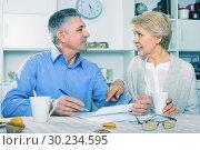 Купить «Mature married couple discuss contract and sign important documents», фото № 30234595, снято 21 марта 2019 г. (c) Яков Филимонов / Фотобанк Лори