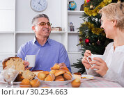 Купить «Mature couple having breakfast at festive Christmas table», фото № 30234663, снято 19 марта 2019 г. (c) Яков Филимонов / Фотобанк Лори