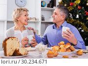 Купить «Mature couple having breakfast at festive Christmas table», фото № 30234671, снято 19 марта 2019 г. (c) Яков Филимонов / Фотобанк Лори