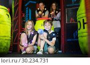 Купить «Kids sitting with laser guns», фото № 30234731, снято 6 июня 2018 г. (c) Яков Филимонов / Фотобанк Лори