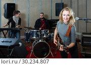 Купить «Joyful guitar player and singer with band», фото № 30234807, снято 26 октября 2018 г. (c) Яков Филимонов / Фотобанк Лори