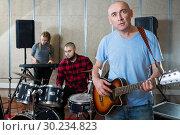 Купить «Adult male singer rehearsing with band», фото № 30234823, снято 26 октября 2018 г. (c) Яков Филимонов / Фотобанк Лори